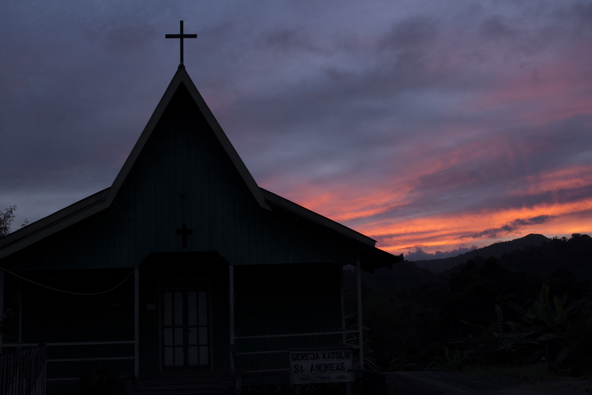 Church in Punan Adiu Village. The history of Catholicism in Punan Adiu was started in 1976 when Italian missionaries and catechists came to Malinau Region. With their education programs, the Punan Adiu and other tribes in the area have gained education and knowledge that would help them in empowering their own community. Most of village leaders who initiated participatory mapping program were students from Catholic school in Malinau.